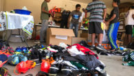 Abhinavhad seven Scouts and several parents and siblings helping him to clean donated soccer equipment and get it ready for shipping to a school in India. He got the idea when he visited his parents' home town there and saw how little the local children had.