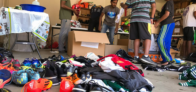 Abhinav had seven Scouts and several parents and siblings helping him to clean donated soccer equipment and get it ready for shipping to a school in India. He got the idea when he visited his parents' home town there and saw how little the local children had.